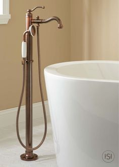 Buy the Signature Hardware 401245 Oil Rubbed Bronze Direct. Shop for the Signature Hardware 401245 Oil Rubbed Bronze Leta Floor Mounted Tub Filler- Includes Telephone Style Hand Shower and save. Vessel Faucets, Tub And Shower Faucets, Oil Rubbed Bronze Faucet, Tub, Tub Faucet, Amazing Bathrooms, Freestanding Tub Faucet, Bronze Faucet, Bathtub Faucet