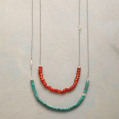 DESERT BELLE NECKLACE--Turquoise heishi beads and carnelian rondelles convey an American Southwest sensibility. One sterling silver strand devoted to each hue