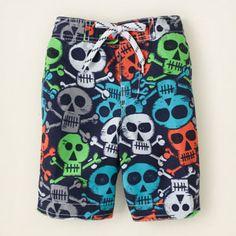 multi-skull swim trunks