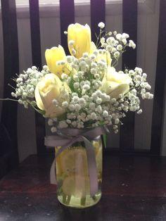 Baby shower flowers centerpiece. Yellow & grey. Babies breath, tulips, roses, mason jar, grey ribbon. Country style. Lemons floating in jar.