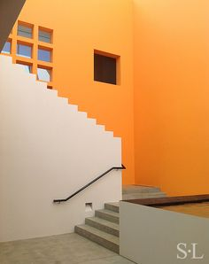 white stepped stairway wall, concrete, by Suzanne Lovell Inc.