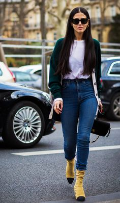 Center your cardigan-friendly look around a few of your favorite colors of the moment. Pick your favorite colored sweater, T-shirt, jeans, and statement boots and let hues speak for themselves in a look that can be as complex or subdued as you like.