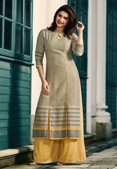 Add grace and charm towards the look in this grey rayon party wear kurti. The wonderful print work in the course of the attire is awe inspiring. Kurti Sleeves Design, Sleeves Designs For Dresses, Neck Designs For Suits, Kurta Neck Design, Dress Neck Designs, Blouse Designs, Chudidhar Designs, Simple Kurti Designs, Kurta Designs Women