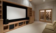 Definitely HIS idea!  Big screen tv (instead of theater screen) with built ins idea for-the-home