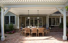 White pergola, slats close together, lighting fixtures