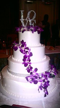 "amazing wedding cake! purple and sparkle! love it! Or could put the ""Great catch"" on instead if doing a beach/fish theme :)"