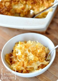 CHeesy Au Gratin Potatoes:  3 tablespoons butter  1 large yellow onion, chopped  1/4 cup all-purpose flour  1 1/2 cups low-sodium chicken broth  1 cup milk  1 ½ teaspoons salt  1/2 teaspoon pepper  1/2 teaspoon dried thyme  2 cups shredded sharp cheddar cheese (8 ounces)  26-ounce bag frozen shredded hash browns  1/2 cup light sour cream    Topping:  3 cups cornflakes, lightly crushed  2 tablespoons butter, melted