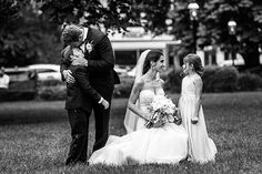 If either of you already have children, there will undoubtedly be plenty of emotional moments with the kids on your big day. This photo perfectly captures one tender family moment.