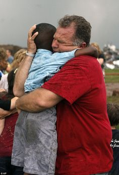 Neighbor realized boy's parents were at work in another city rushes to make sure his friend is okay after Oklahoma tornado. Emotional Reunion: Jim Routon hugs Hezekiah Darbon at Briarwood Elementary school after a tornado destroyed the school in south Oklahoma City, Monday, May 20, 2013