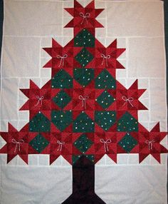 this could be pretty with the stars in various greens and the blocks in ornament colors, and a golden star on top