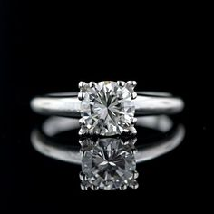 The perfect vintage diamond solitaire! This ring features a 1.00 carat transitional round brilliant cut diamond set with claw prongs in a vintage 14 karat white gold ring.    You must click on this to see the fabulous setting!!
