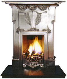 A distinctive Art Nouveau inspired Cast Iron Combination Fireplace with ornate Celtic period ornament