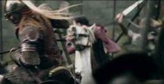 Helm's Deep, Arwen rides and fights - riding between Eomer and Legolas photo unusedscene299ArwenatHelmsDeeponAsf.jpg