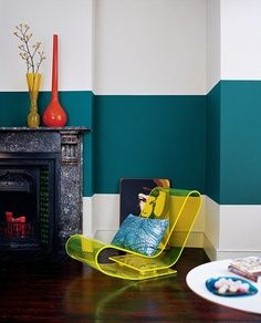 a light background and a dark block of color-i'm actually considering this shade of teal for my own walls and this is a great example of how to use dark color.