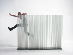 A room divider is a screen or piece of furniture placed in a way that divides a room into separate areas. The folding room screens were found in China in