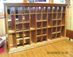 Shot Glass Display Case | Plans and instructions to make a beautiful shelf for our collection. Looks like a bit of work though.