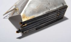 Nicola Lillie BA (Hons) Elements II degree collection.  Silver, Gold and Steel. Photocredit Martin Avery.