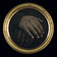 Daguerreotype button with an abolitionist motif that may be one of the first political buttons made in America to incorporate a photograph. Two hands, one black, one white, resting on a book.