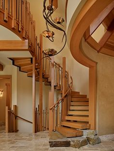 This is gorgeous! And I love love love the lines of that chandelier! Although I happen to know that wood spiral staircases do not mix well with socks, which I happen to love wearing at home.