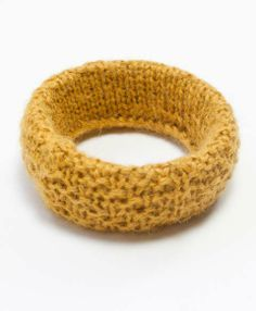 A design of knitted alpaca wraps itself around a gourd bangle.