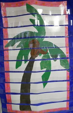 Chicka Chicka Boom Boom Tree painted on a poster and cut to fit into a pocket chart, COOL!