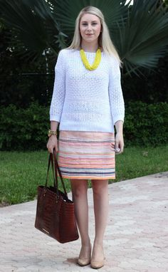 neon striped dress, white perforated sweater, neon yellow necklace, business casual
