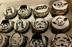 Star wars cupcakes with stencilled characters.