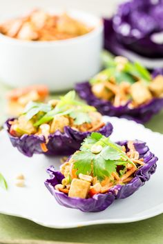 """Thai Peanut Tofu Salad Tacos from @Angela Gant It kind. If you don't love the whole cabbage """"wrap"""" thing, you could always just put all the veggies through the shredder of your food processor and toss with the tofu, dressing, extra peanuts and cilantro for a one-bowl thai """"slaw"""". Not nearly as pretty as this, though."""