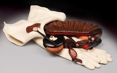Creatíve and applied art ~ The Art Work Of Denise Nielsen and George Worthington ~ Walnut Purse, Bloodwood Handles Holly Gloves Holly and Purpleheart Handkerchief Ebony Compact, Holly Ginko with Mahogany Puff African Blackwood, Maple and Bubinga Brush African Wonderstone and Pink Ivorywood Lipstick African Blackwood, Maple Ebony Pencil Purpleheart Eyeglasses with Translucent Orange Alabaster Lens Translucent Orange Alabaster and Ebony Perfume Bottle