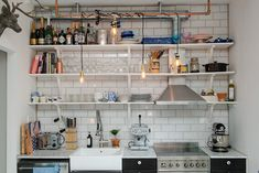 Howard Interior Design open kitchen shelves + blue subway tile backsplashThe Design The Design is the first full-length album by the mathcore/metalcore band Into the Moat.