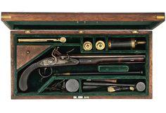 ".50 cal., 11"" flintlock rifled barrel, marked H. House on top flat. Walnut stocks; plate on left side has three silver escutcheon p..."