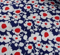 Love the simple, bold graphics in this vintage 1960s Marimekko-style flower power fabric yardage. Red, white  blue retro fun! by AngelGrace on etsy.