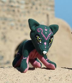Emerald Fox with pink ornaments