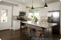 DIY Blogger House in Utah: Wall Color - BM Silver Fox, White Cabinet Color - Snowbound, Island Color - Benjamin Moore Bear Creek, Granite Color - Kashmir White, Stools - Overstock.com, Decor - HomeGoods and ZGallerie