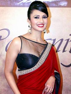 http://www.fashion4style.com/woman/clothing/bollywood-replica-saree/red-white-&-black-combination-designer-saree/pid=MTM1