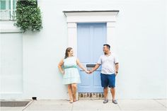 Summer Engagement Session in front of blue door in Downtown Charleston by Catherine Ann Photography