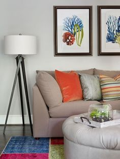 """A tripod-shaped floor lamp adds an informal touch to the room and can be easily moved. The multi-patterned rug by Creative Touch allows for a variety of accent colors. """"Whenever there are young children in the house, we like to add a bit of color and whimsy with a rug like this,"""" adds Kole."""