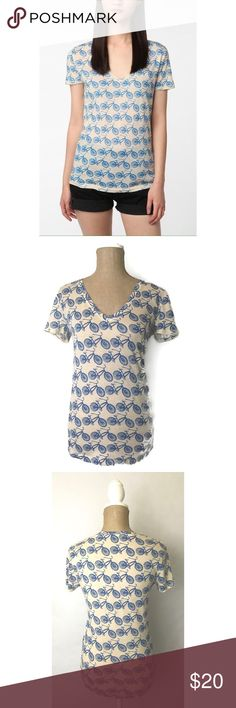 Urban Outfitters BDG Bicycle Print Tee Top Info:Urban Outfitters BDG Top Ivory Blue Short Sleeve Bicycle Print V Neck Tee - Condition: Pre-owned - Tag Size: S  *** Please see measurements below - Material: Cotton/Polyester - Care: Machine Wash - Flat Measurements: Bust (armpit to armpit) - 16 inches (size 32) Length - 25 inches - *** Any known defects (i.e. rips, stains..etc) - if present - on an item will be disclosed under item condition and highlighted in the listing photos. Urban…