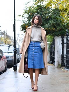 sophisticated '70s style: camel coat + cozy knit + button-up denim skirt