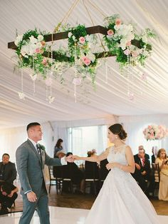 Outdoor wedding tent with hanging flowers over the dance floor