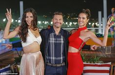 Newly single: The Victoria's Secret Angel, pictured with Seacrest and Ambrosio during their Olympics coverage, finalized her divorce from Serbian NBA player Marko Jaric in March