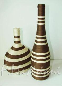 Garrafa decorada com linha