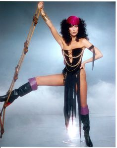 Good thing this rope ladder happened to be here so our Cher can best display her crotch tatters.