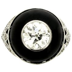 Art Deco Diamond Black Enamel Ring | From a unique collection of vintage cocktail rings at http://www.1stdibs.com/jewelry/rings/cocktail-rings/