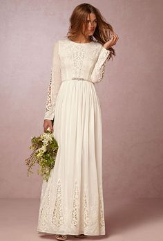 Brides: BHLDN. See more details from BHLDNLace inset sleeves let a bit of skin show through on this elegant, laid-back dress from The Jetset Diaries. High neckline and a minimal silhouette gives it an easy, no-fuss vibe.
