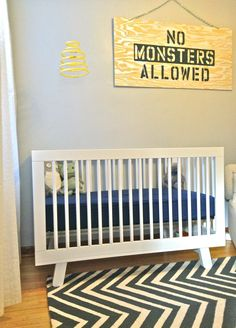 BabyLetto Hudson crib in white w/ gray chevron rug and adorable wall sign