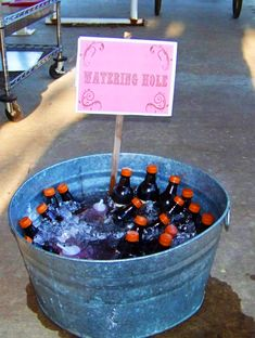 cowgirl party watering hole! Root beer and pink kool-aid bottles :)