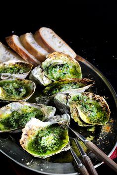 Grilled oysters with herbed anchovy butter. Oh...so...good!