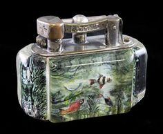 A Dunhill aquarium lighter, with lucite panels decorated with fish and water weeds, 4in.