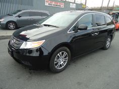 2011 HONDA ODYSSEY EX-L  THIS IS A SALVAGE REPAIRABLE VEHICLE WITH REAR END DAMAGE . RUNS , DRIVES HAS LEATHER INTERIOR AND ENTERTAINMENT SYSTEM. For more information and immediate assistance, please call +1-718-991-8888